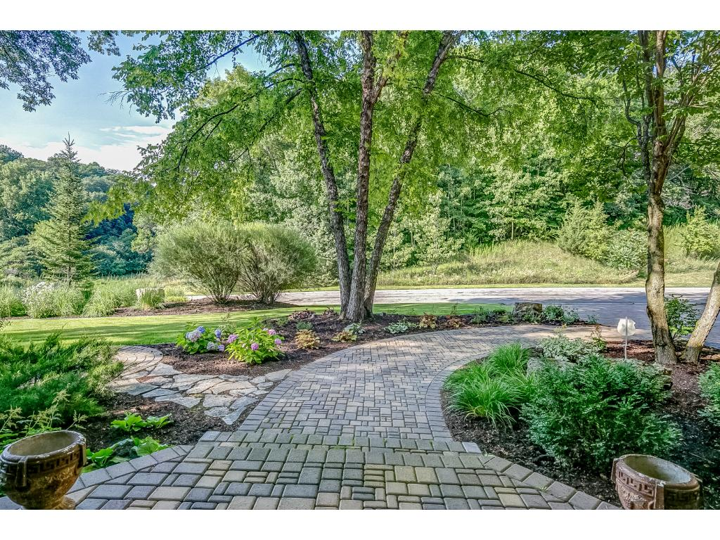 This home features lush landscaping and a view of the adjacent pond out your front door.