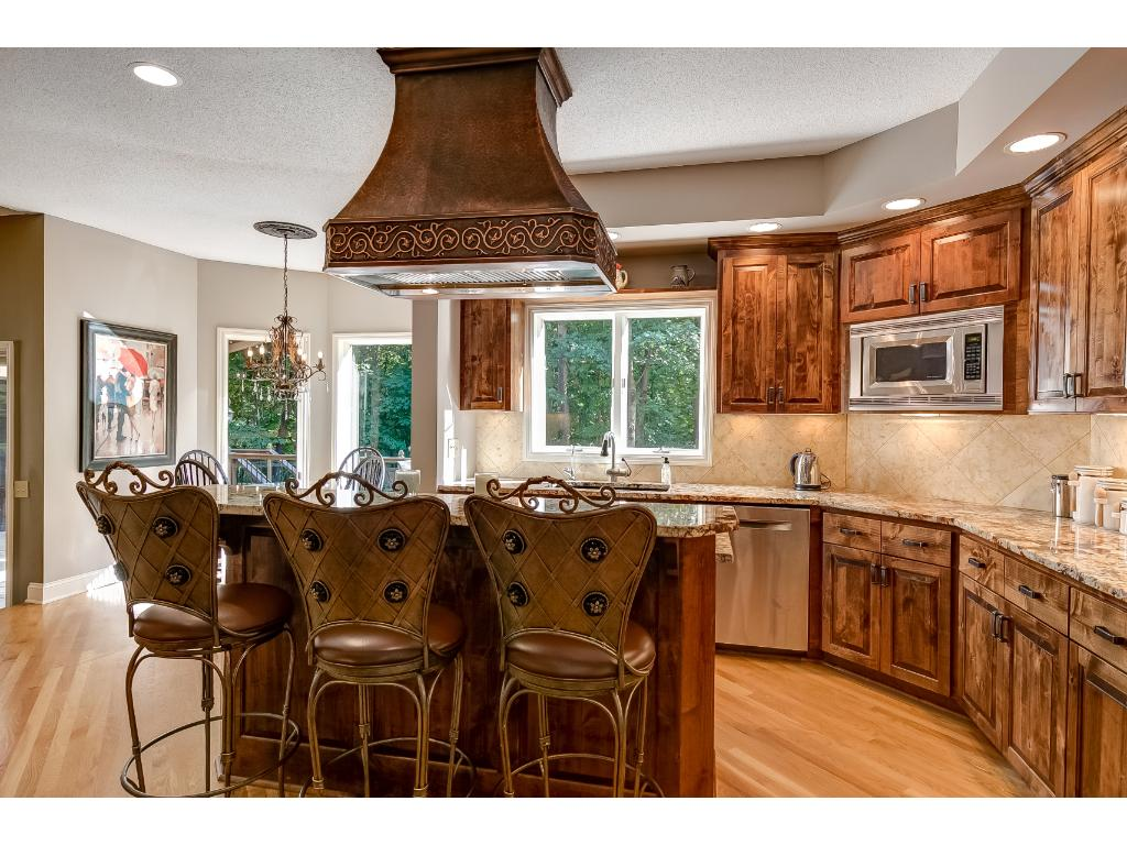 You will love the gourmet kitchen with custom cabinetry, a double oven, and granite counter tops.