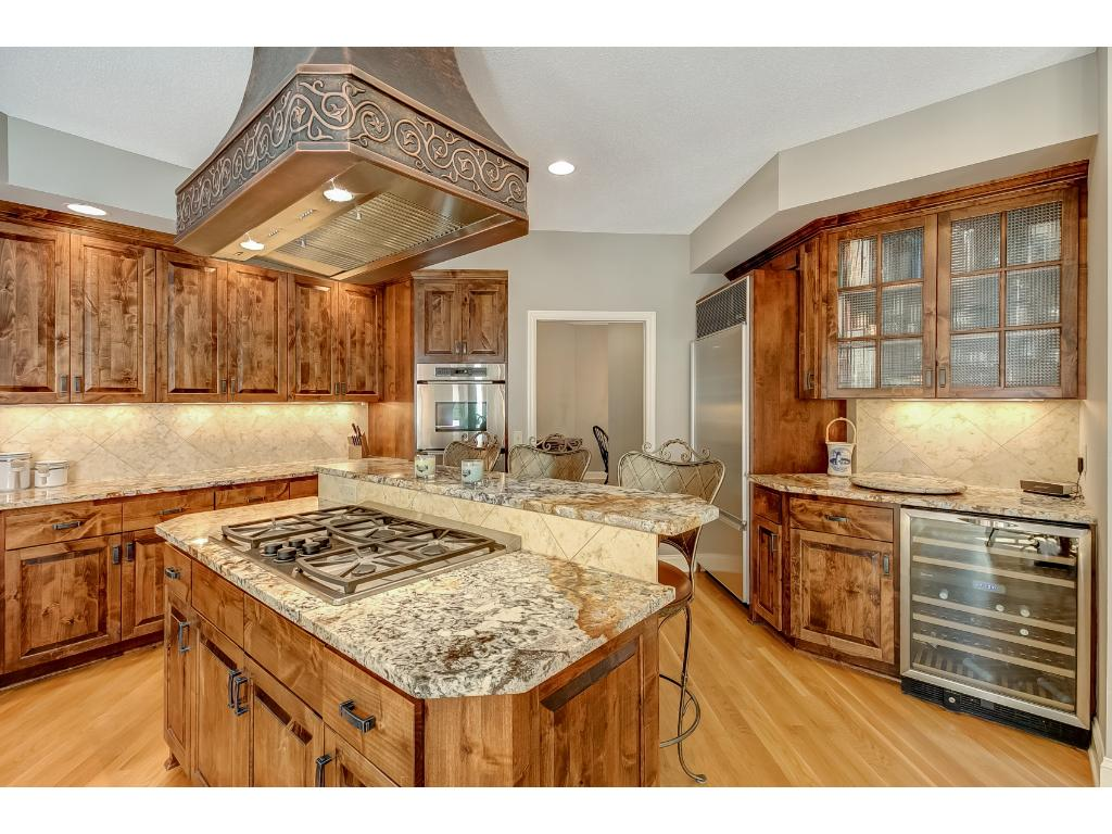 The kitchen opens up to the informal dining area and living room for a great room concept.