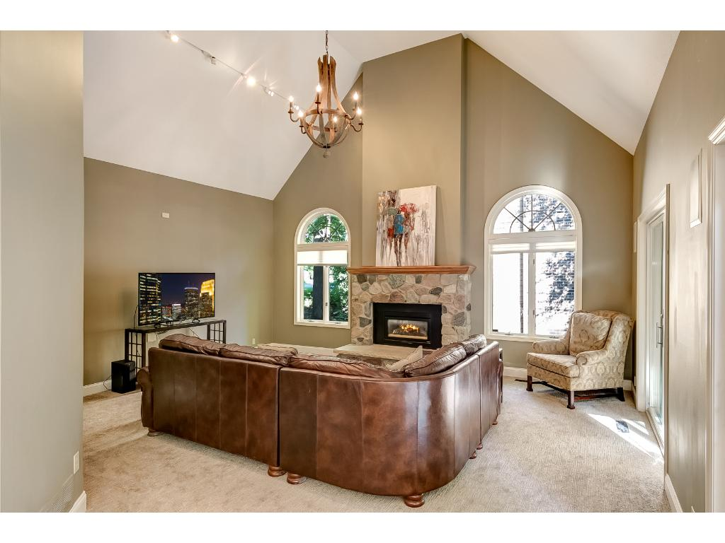 The 2-story vaulted great room is adjacent to the kitchen and 4-season porch.