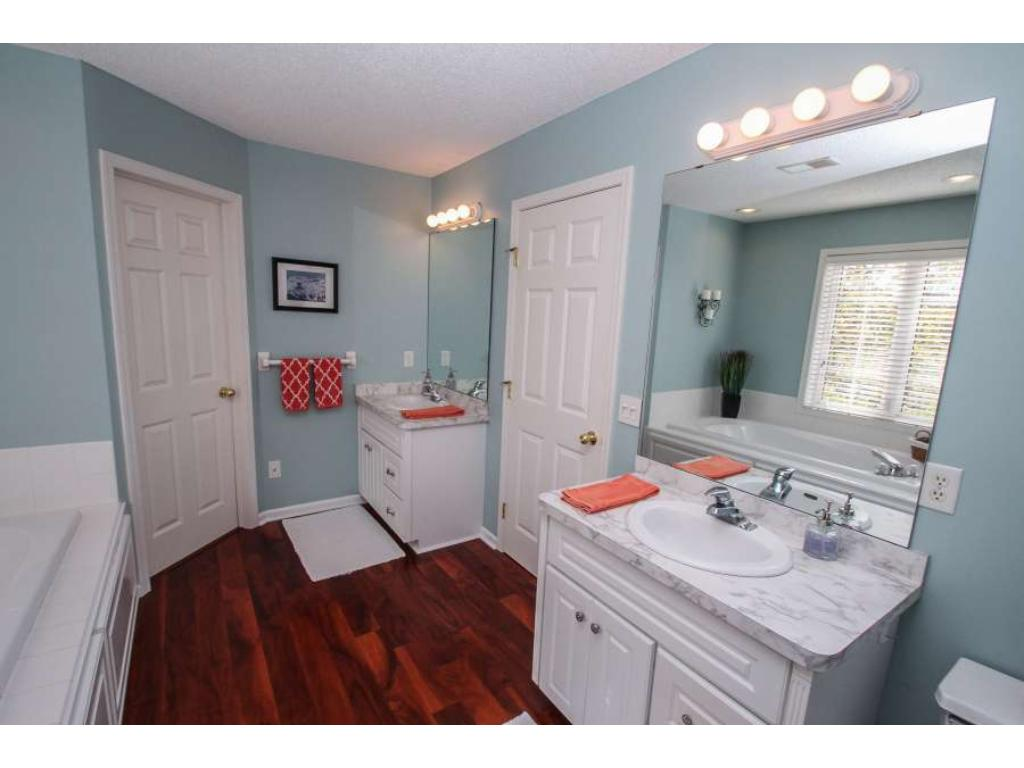 Deluxe owner's suite bath with double sink vanities, separate tub and shower.