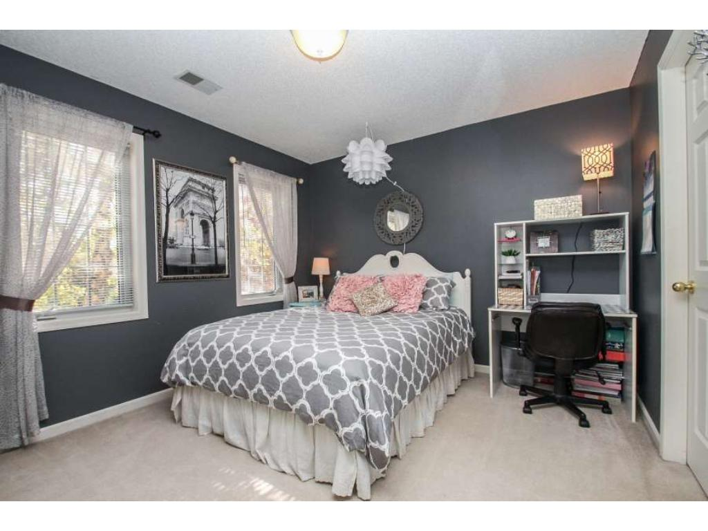 Three bedrooms on upper level.  Generous sized secondary bedrooms feature walk-in closets.