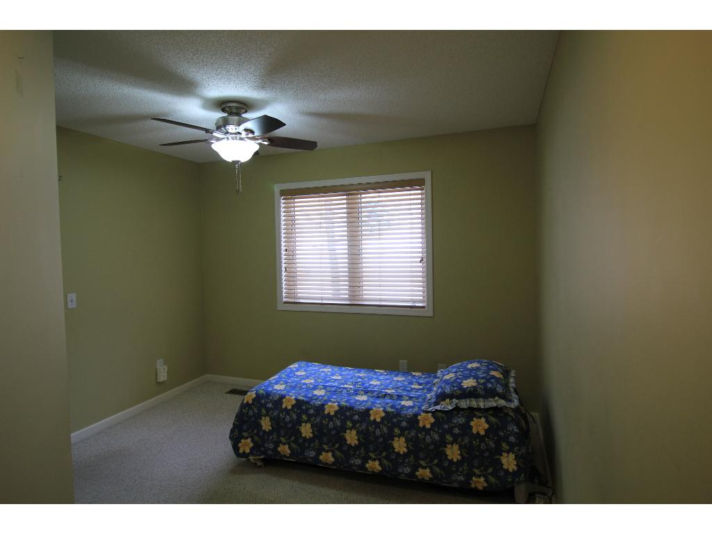Three bedrooms on upper level. Secondary bedrooms feature walk-in closets.