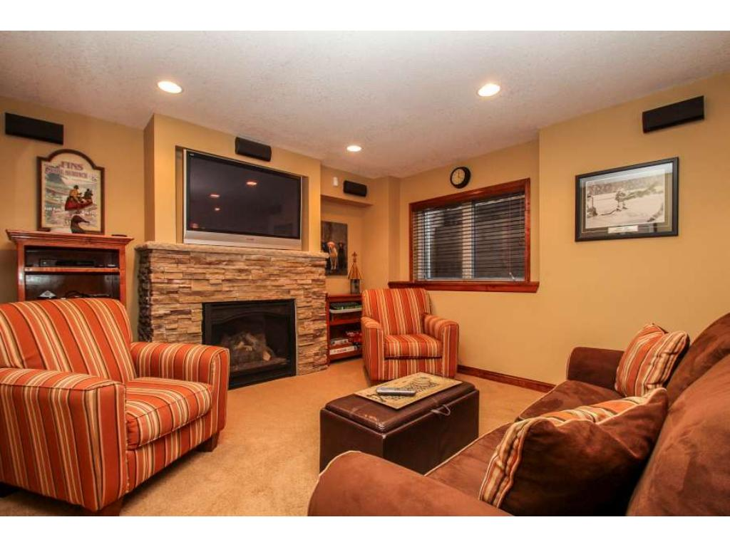 Spacious lower level family room offers recessed lighting, surround sound, custom stone fireplace and expansive bar! Great space, great options!