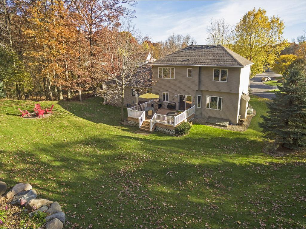 Quiet cul-de-sac living! Private rear yard adjoins Woodland Trails Park, a 427 acre park with dense woods, prairies and wetlands which includes the 4.75 mile paved Great Northern Trail. Area behind garage is wired for a future hot tub. IMAGINE!