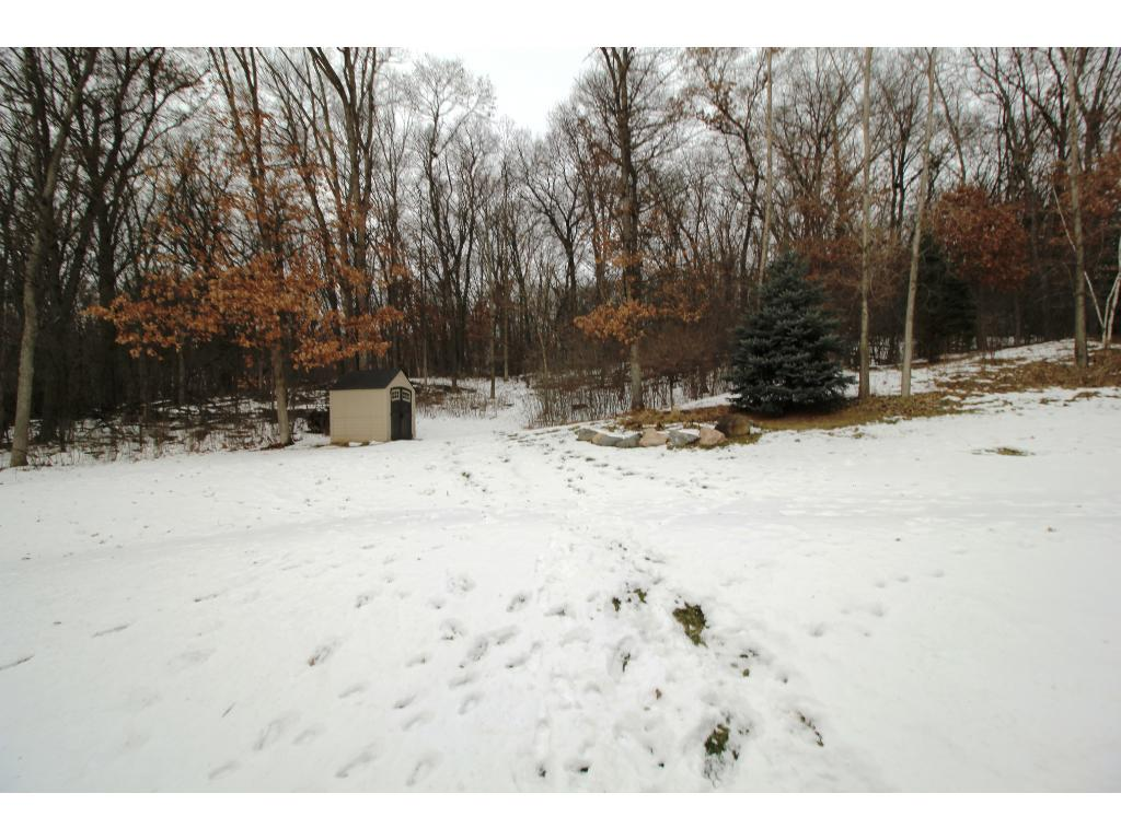 Sprawling maintenance free deck overlooking private, wooded rear yard. Cozy up to the attractive outdoor fireplace. Wow your guests!