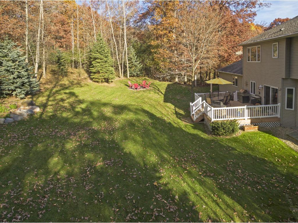 Premium, private back yard view! Enjoy nature at its finest. Gorgeous tree cover, ample area for the kids trampoline and play set. Deer, birds of many species are frequent visitors.