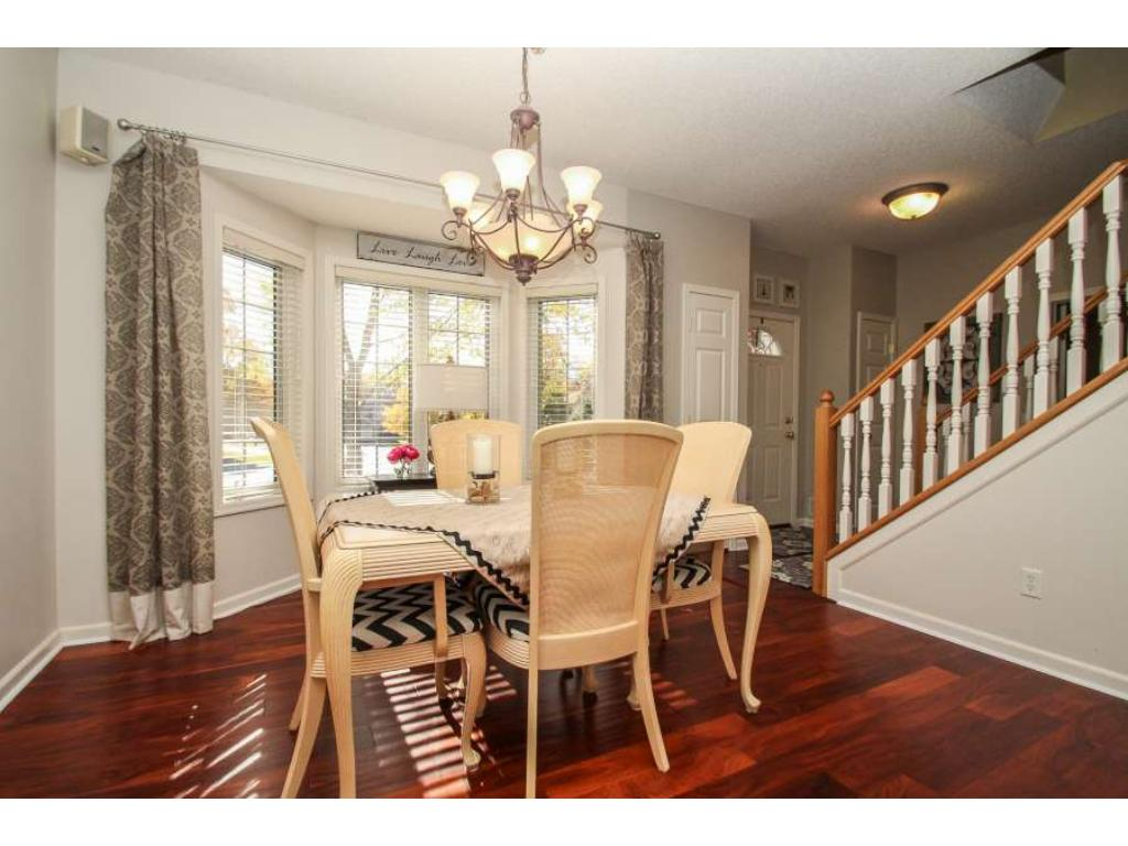 Formal dining room with gleaming wood floors and sun-splashed south facing windows.