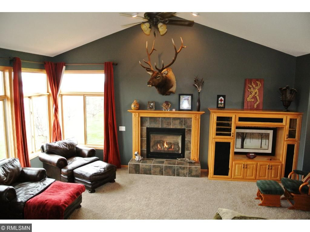 Vaulted main level Great Room loaded with light from windows on 3 sides. Enjoy the gas fireplace and built-in entertainment center.