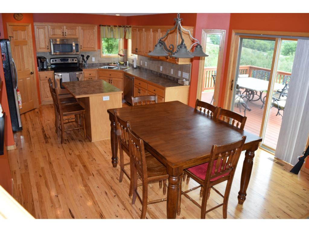 Comfortable family Kitchen opens to huge Deck & views of the orchard.