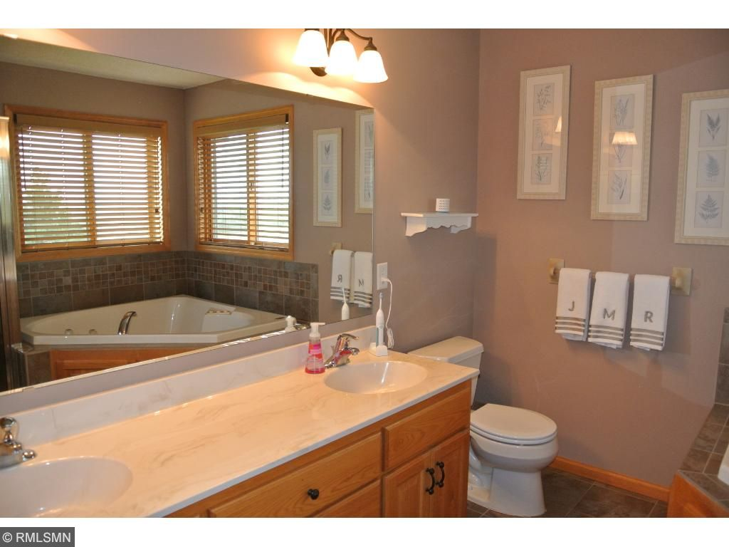 Private Owner's Bath features double vanities & tile flooring.