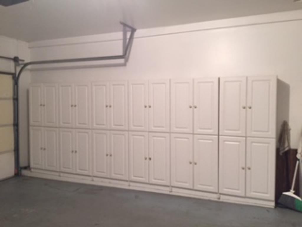 Built-in cabinets for storage in the garage.  A full wall of pegboard in the garage, as well.