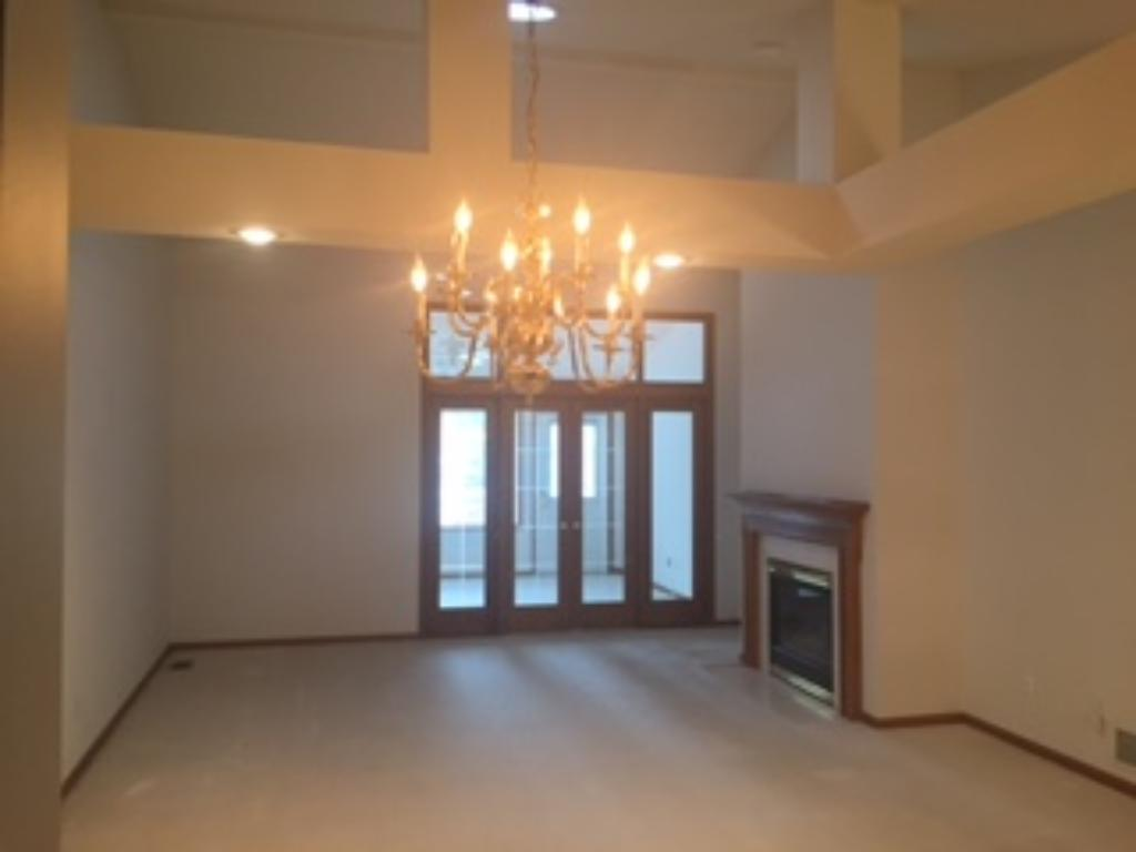 Main level includes living & dining and a 4-season room!