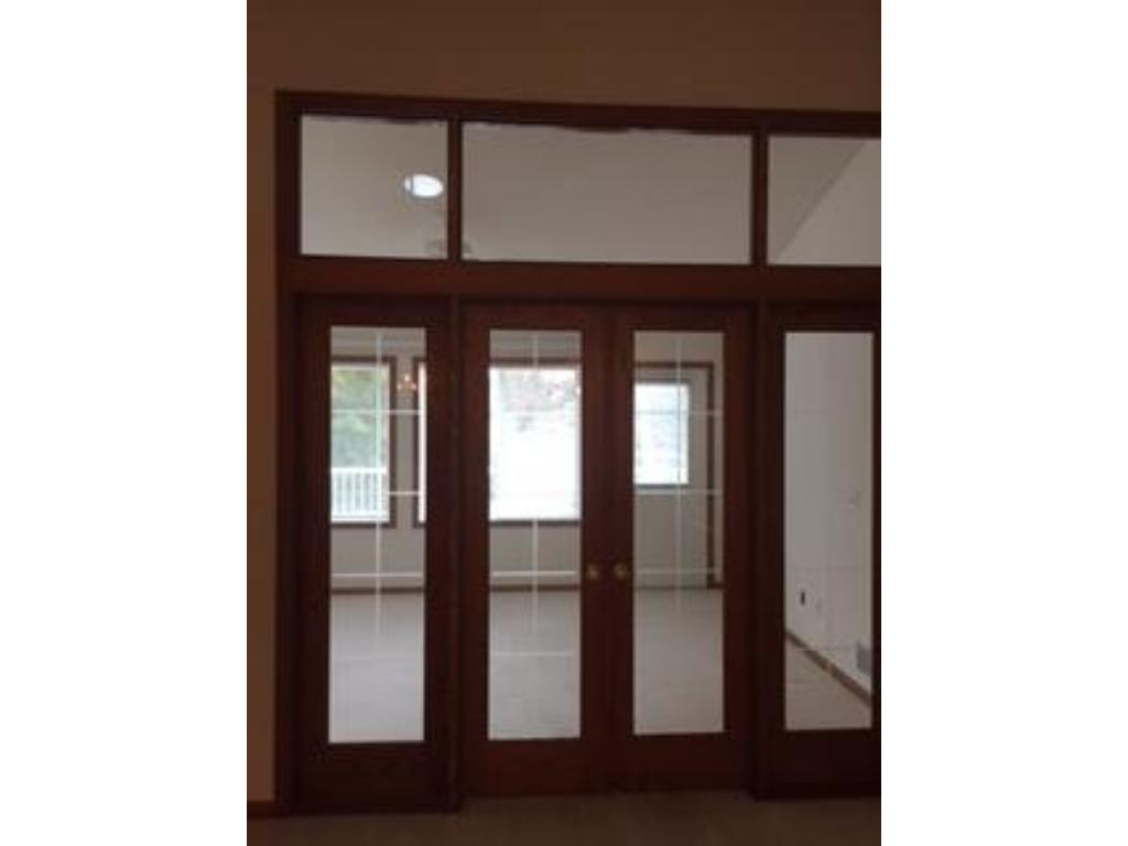 Glass etched atrium doors to the 4-season room.  This room opens to the deck (30'x10').