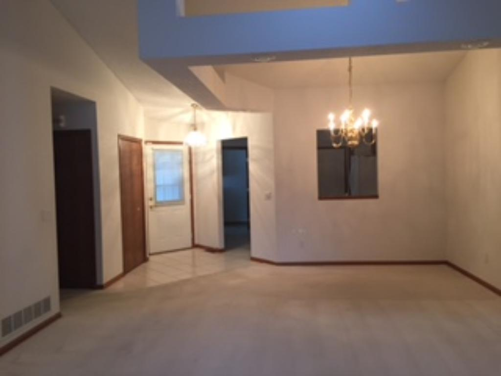 Open - vaulted main floor living room.  Two bedrooms on the main level and two baths + laundry room with cabinets.