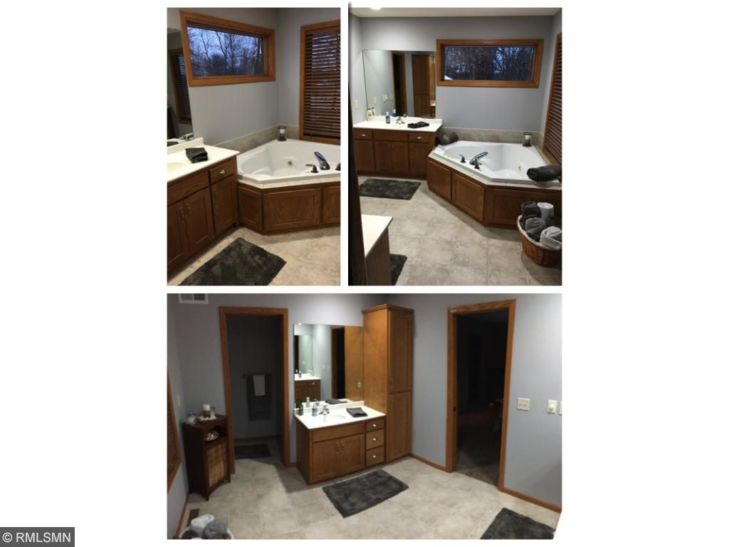 Master Bath with whirlpool tub and seperate shower. Duals sinks and freshly painted with lots of windows.