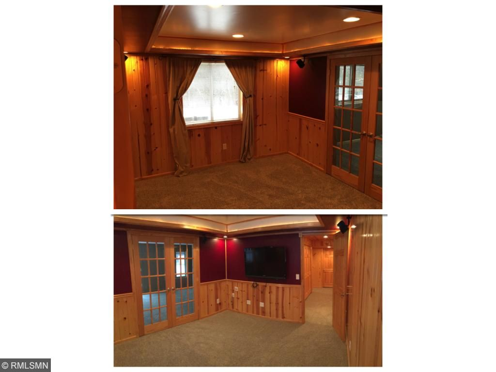 Media room, with surround sound in knotty pine and theater lights.