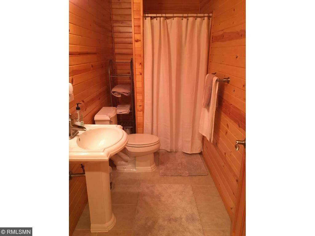Lower level bathroom in knotty pine