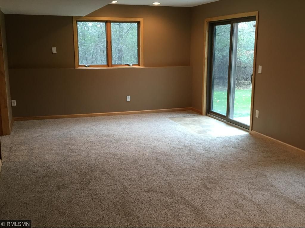 Lower level rec room area with walk out to patio. Mechanicals include new furnace and A/C.  Home also has extra large water heater.