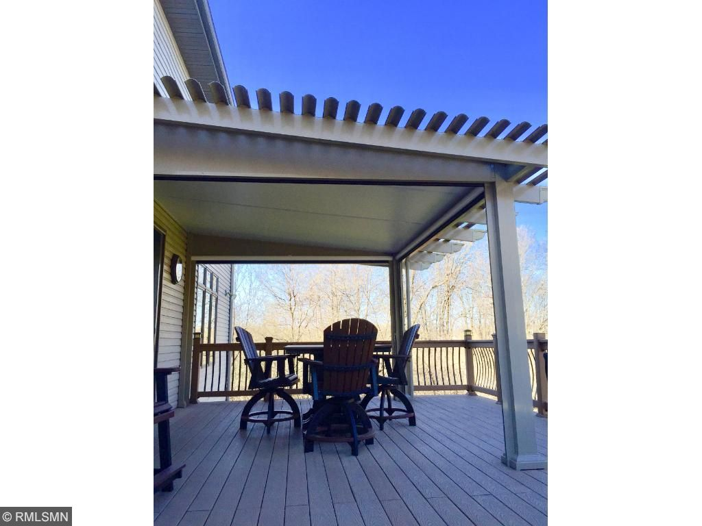 Large deck with Temo sun patio cover on the maintenance free deck.  Screens can be up or down for bug free summer enjoyment.