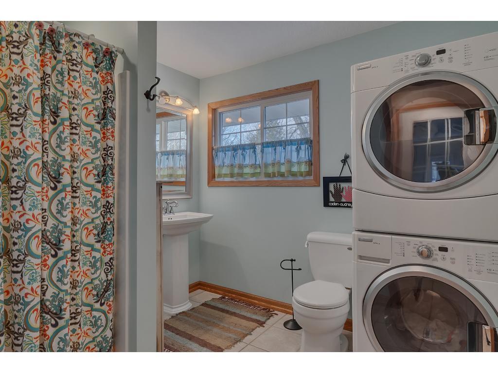Main floor 3/4 bath with laundry area