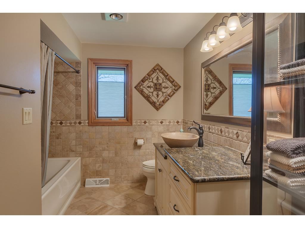 This full bath was totally remodeled to feature ceramic tile through out and a trendy, vessel sink.