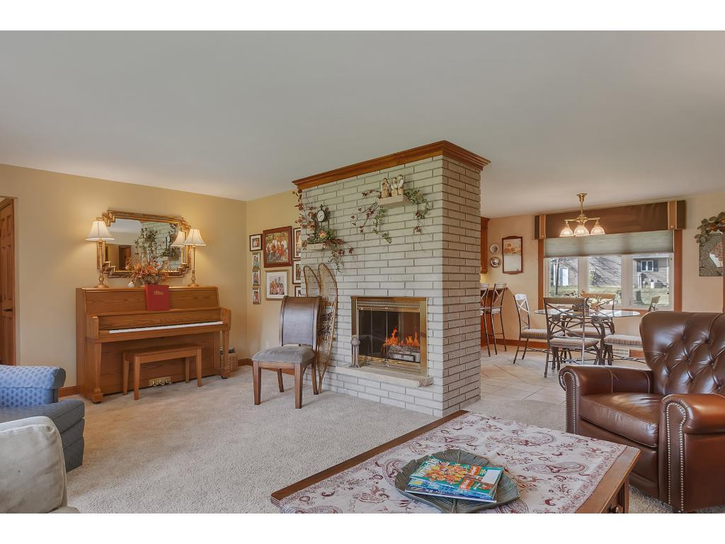 You will love the cozy feel of the double sided fireplace!