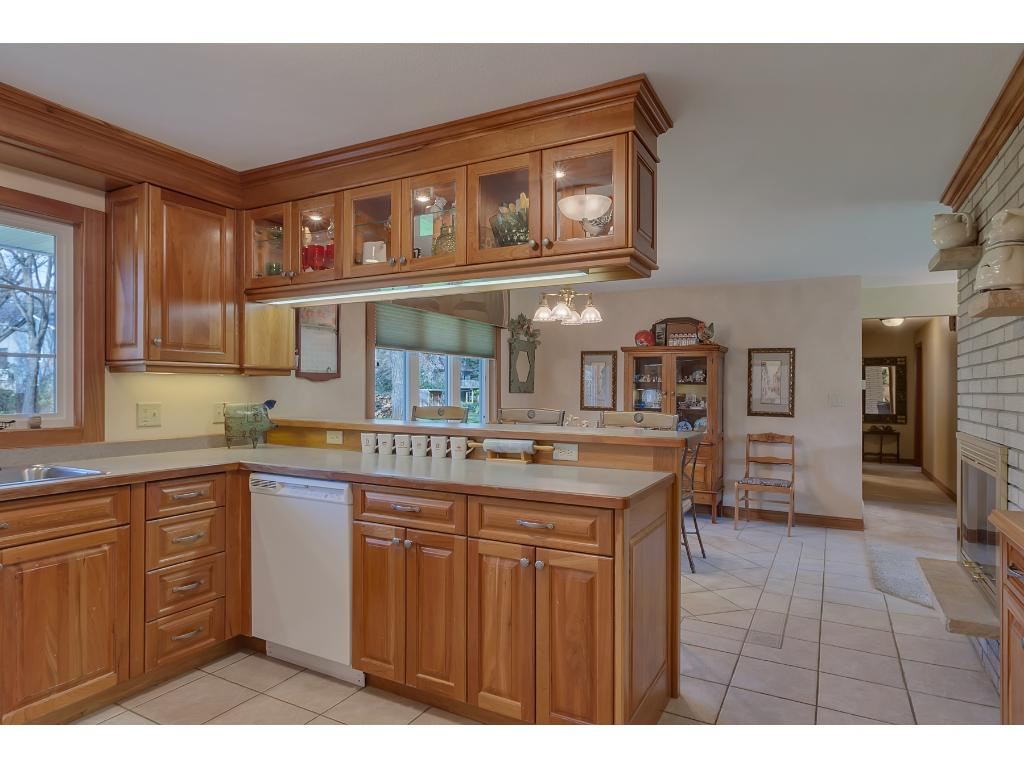 Cherry cabinets make this kitchen very inviting