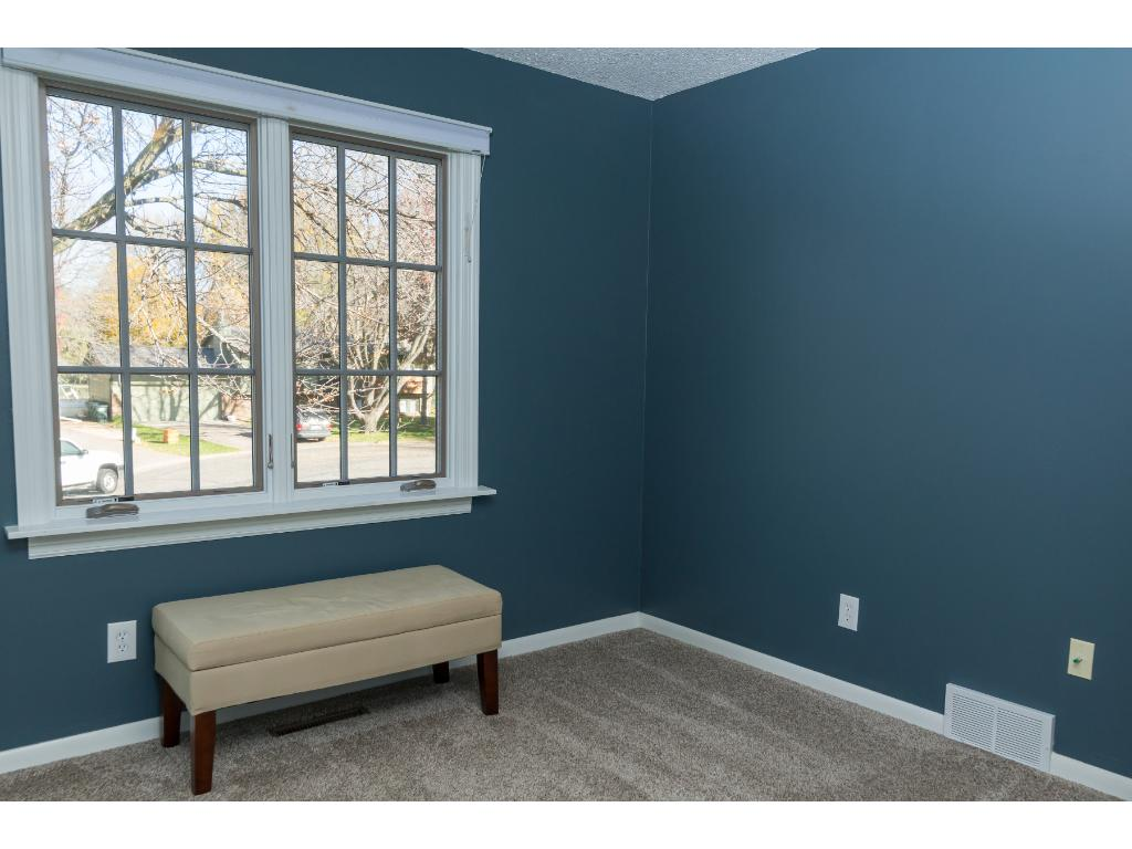 Bedroom 2 upstairs - well-lit and spacious with a nook as well. Don't miss the light switches in the closets!