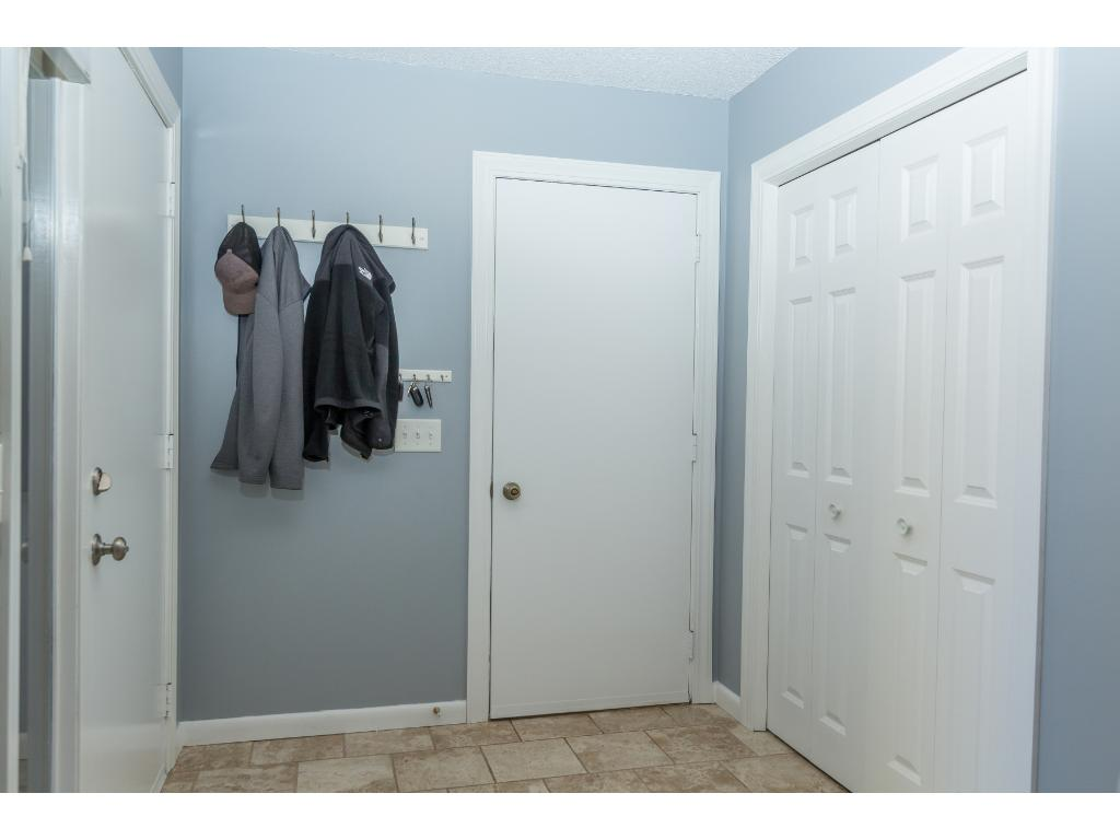 The foyer is a quality, large entry way. You won't feel cramped here. There's also a light in the generous coat closet!