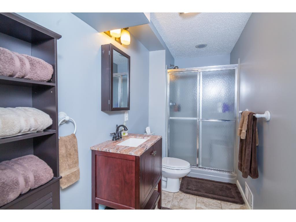 The lower level 3/4 bathroom has nice finishes and an updated vanity. Plenty of room for activities!
