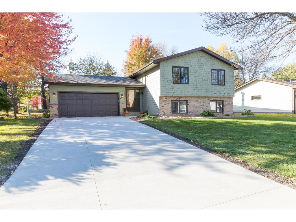 Welcome to the cul de sac, Badger Court! This updated split-level home is ready to go. A new concrete driveway, new landscaping, and a beautiful yard really provide some dandy curb appeal! The garage also has an additional space with a work bench.