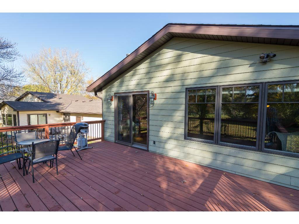 Lovely back yard with plenty of room to run. The landscaping is all the way around the home and the trees provide beauty and a nice level of privacy. Check out the large deck!
