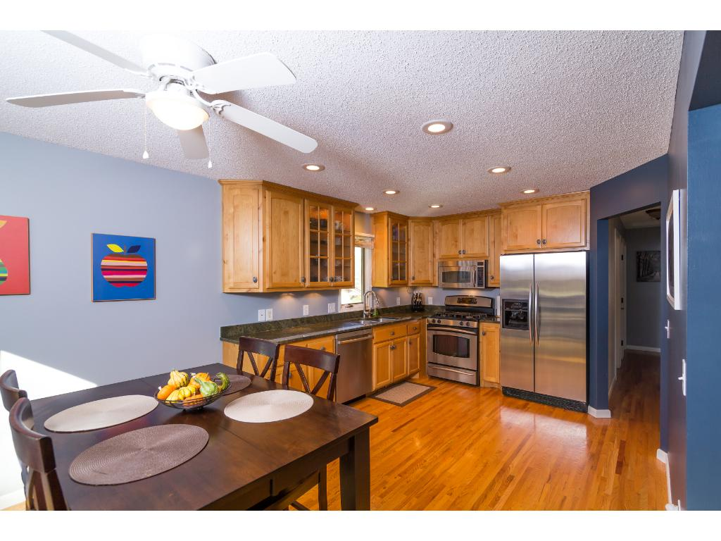 The kitchen is updated, spacious, and well-lit. The open floor plan makes great use of the space and the sliding door to the deck is fantastic!