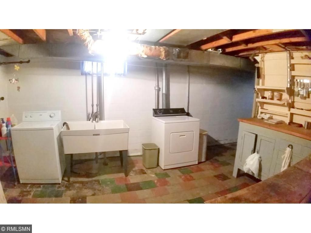 Large laundry area with super workbench area.