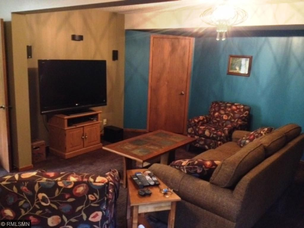 Spacious Family room in lower level. This room is L-shaped and measures 77x22 plus 12x11.5