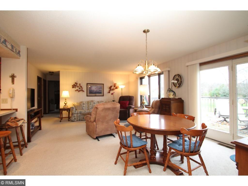 Open living/dining room plan.  Sliding doors to deck in back.
