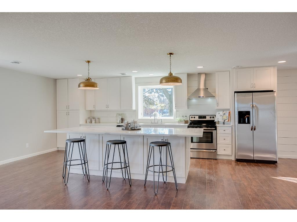 Stunning kitchen with 10 ft island perfect for breakfast in the morning or entertaining.