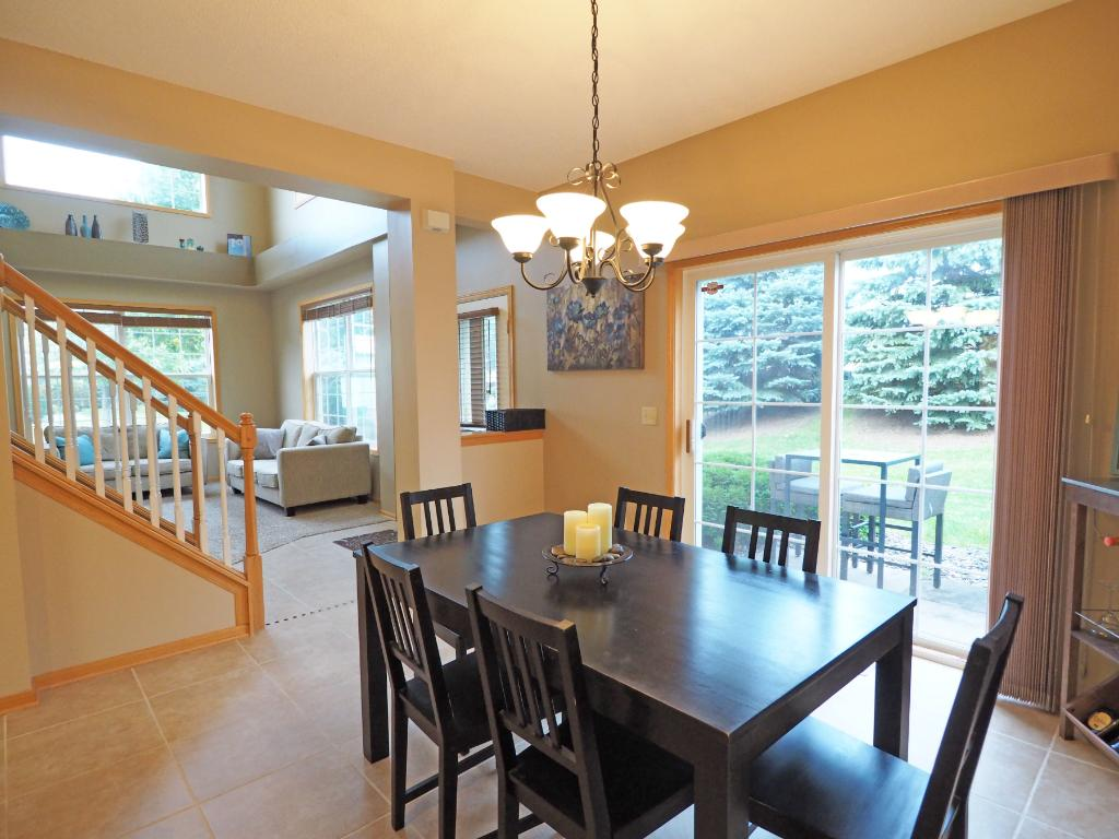 The dining room features sliding doors lead out to the patio.