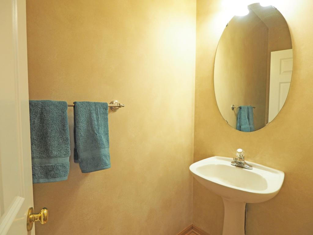 A half bath is located right off the kitchen.