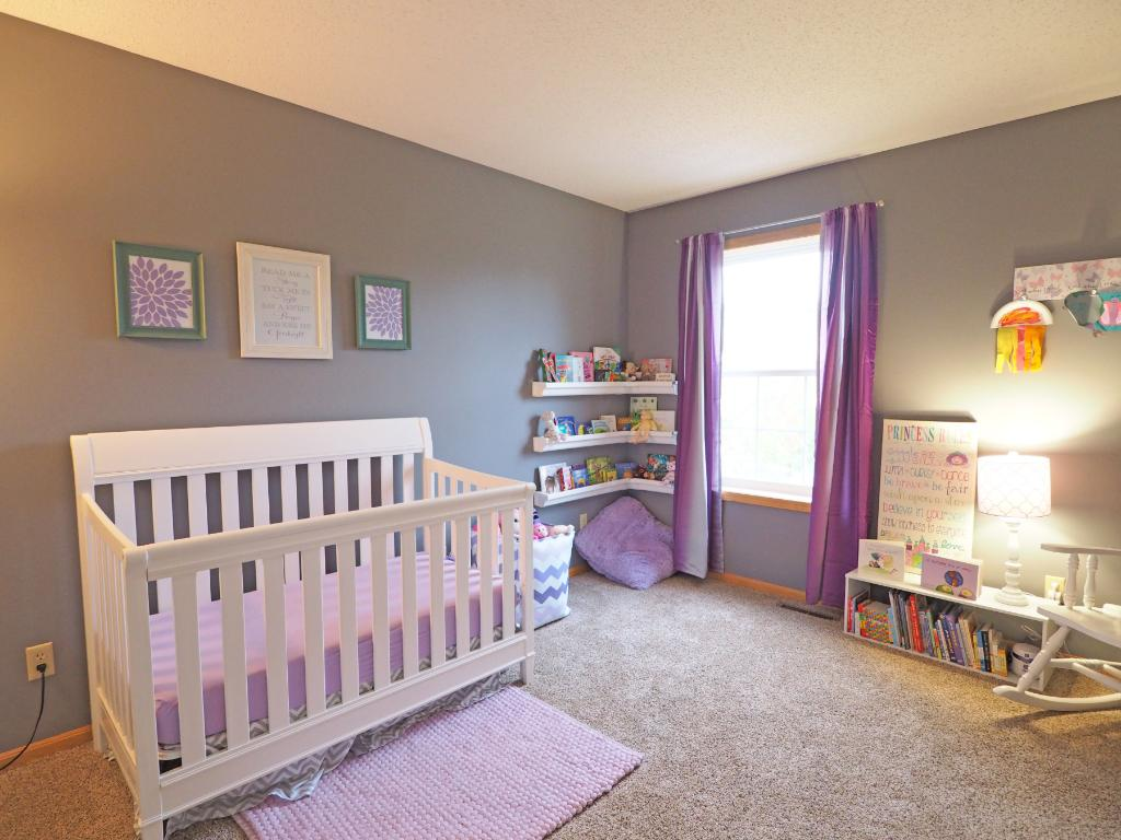 The second bedroom is spacious and bright.