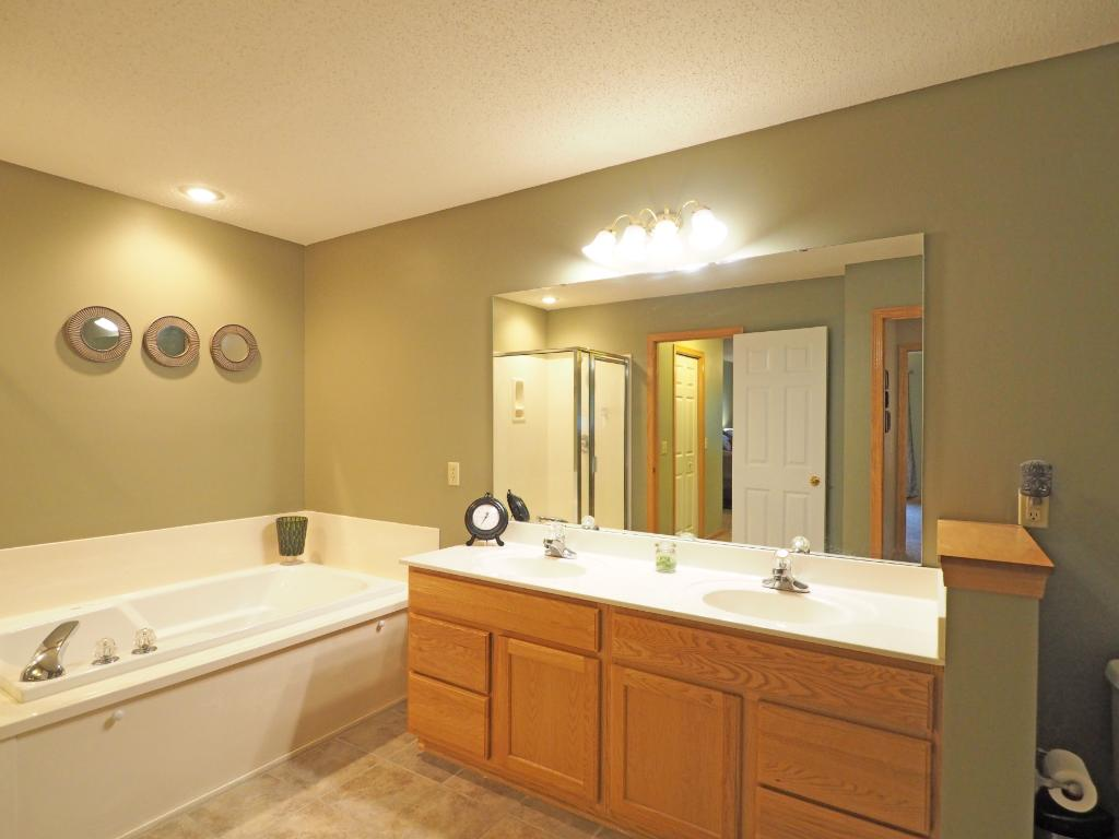 The upstairs bath features a double sink.