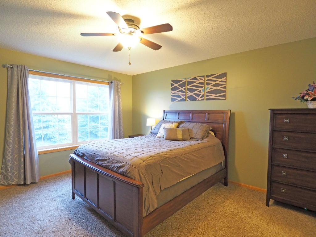 The master bedroom features a huge window that lets in tons of natural light.
