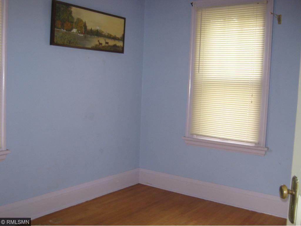 Main floor bedroom with maple floors