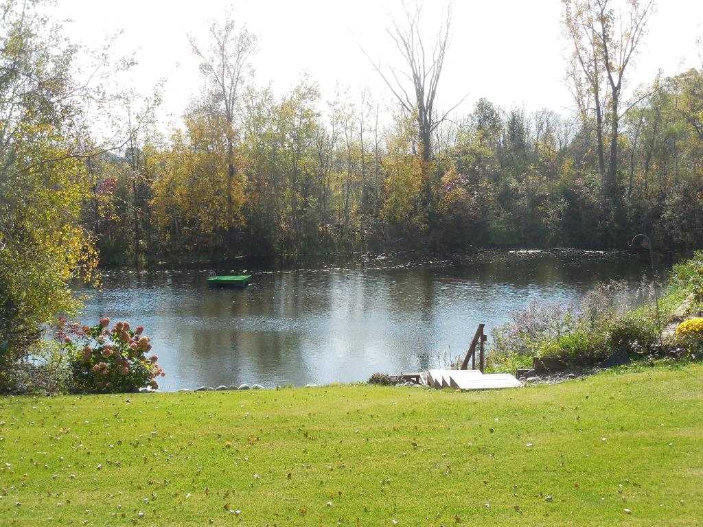 This home boasts a gorgeous lake setting! Don't miss this opportunity!Enjoy great outdoor activities!This view is a small area of the spring fed lake. It extends down and around the other side.