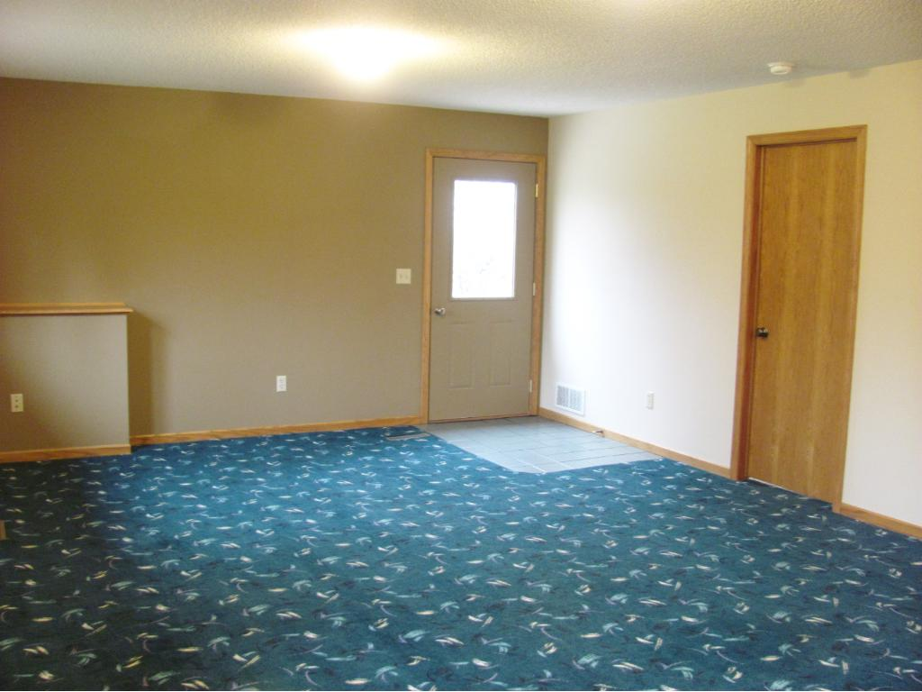 3rd  level walk out family room. Walkout out to a patio.