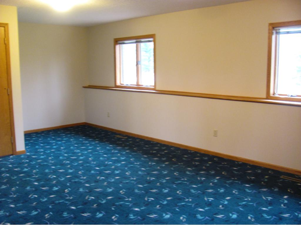 Another view of the family room. there are pipes already behind  the wall if the buyer wanted to add a wet bar or kitchenette. This space could be a separate living area.