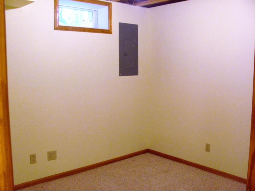 Extra room off of the 2nd family room. could be an office, craft room, exercise room. Ceiling is not finished.