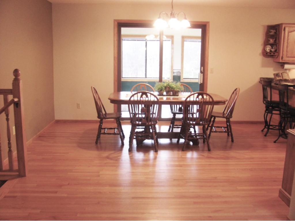 Dining area with gleaming redone hardwood floors. Dining area leads to the 3 season porch.