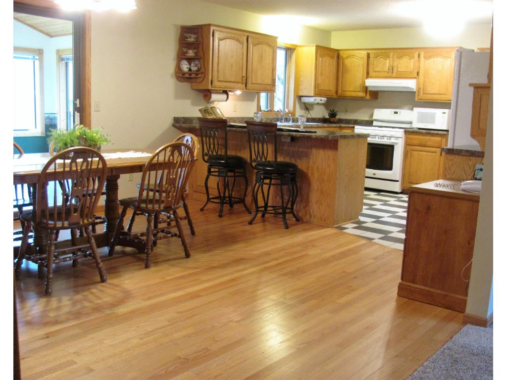Kitchen offers a lot of storage space and a breakfast bar. There is a mud room and 1/2 bath off of the kitchen.